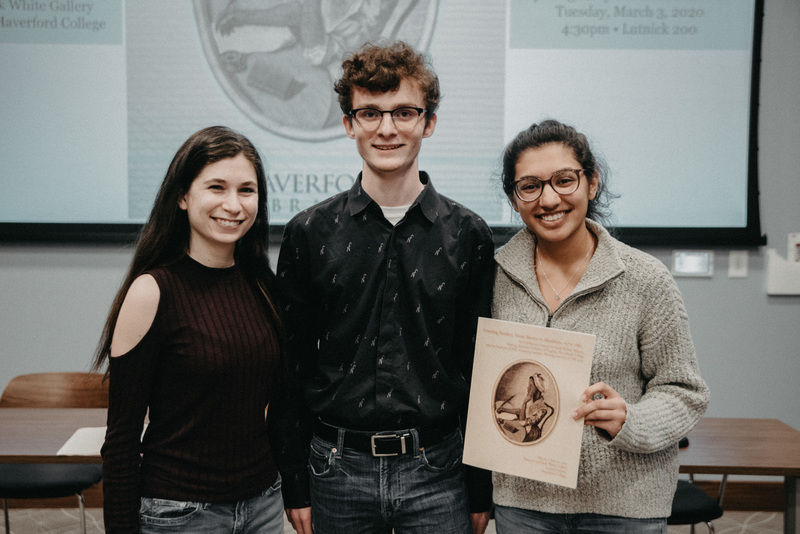 The three student speakers at the exhibition opening, Rachel Schiffer, Aidan Chapin, and Natasha Bansal, pose with the exhibition catalog.