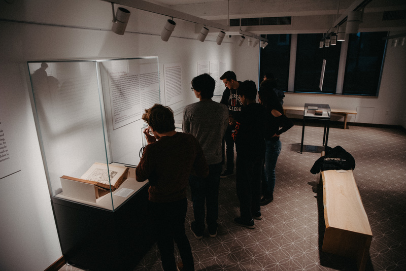 Students view the exhibition during the opening reception.