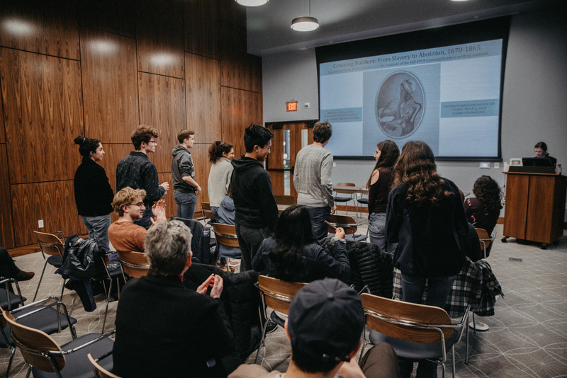 Student Curators stand for acknowledgement