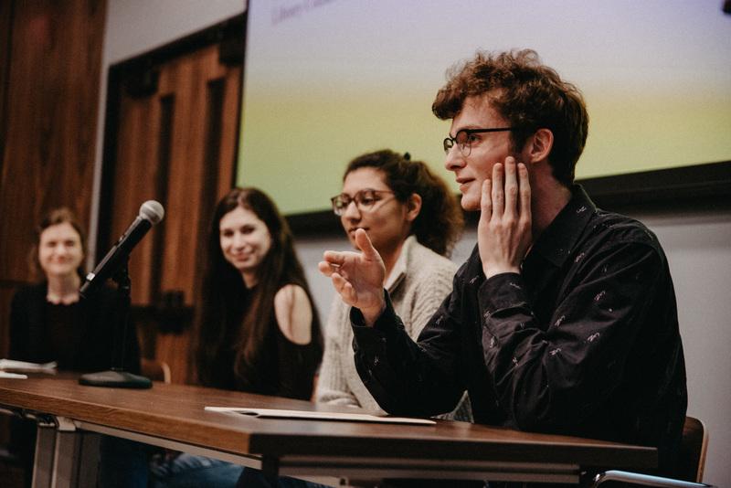 Student panelists, Rachel Schiffer, Natasha Bansal, and Aidan Chapin, speaking at the exhibition opening.